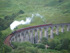 """Hogwarts Express"" rolls on the Glenfinnan Viaduct in Scotland."