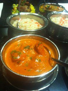 Pollo con curry y leche de coco en Tandoori Statio, Madrid, Spain