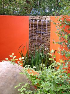 Contemporary Water Feature. - Probably wouldn't do an ORANGE wall. but the fixture is lovely and I like the idea of an 'accent' color for the wall. Hmm.. maybe a rich teal or turquoise?