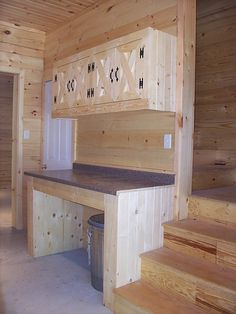I love this! Here's my table for feed mixing and some cabinet space AND there are stairs behind the feed room! It would be perfect access for my loft. <3