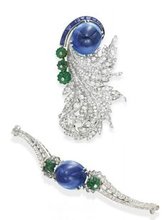 A DIAMOND, SAPPHIRE AND EMERALD BROOCH, BY PAUL FLATO   Set with a detachable sugarloaf sapphire, weighing approximately 49.51 carats, accented by a tapered coil of calibré-cut sapphires and a graduated line of three carved emerald beads, each topped by a collet-set diamond, extending old European and single-cut diamond curling leaves, mounted in platinum, (accompanied by a contemporary bracelet mounting of later addition, with a central fitting for the cabochon sapphire from the brooch)