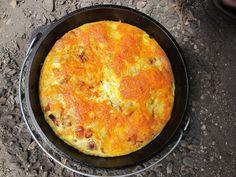 Dutch Oven Breakfast Casserole - butter - 12 eggs - 32 oz. Ore-Ida Hash Browns - can diced green chilies - onion - shredded cheddar cheese - diced ham - salt - pepper