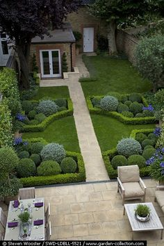 Terrace with dining and seating area and a path running through a formal garden. Garden design by Louise del Balzo. Photo by Steven Wooster. Via http://www.garden-collec....