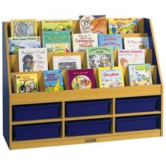 Extra-wide, extra-handsome combo center keeps books where they're easy to see and reach! Floor unit features four generous, deep display shelves on top and six cubbies on the bottom for storing additional books or supplies. Book Display Stand, Display Shelves, Small Tray, Large Tray, Cubby Storage, Storage Compartments, Classroom Furniture, Kids Furniture, Library Organization