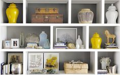 White shelving with gray background.  Pops of color for accessories.