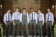 groomsmen in suspenders and groom in vest
