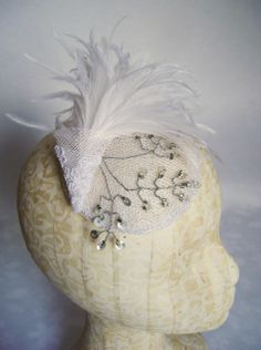 Sinamay diskette with ostrich, lace and sequined spray