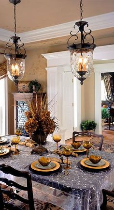 Two lighting fixtures in the dining room. Plum & Crimson Interiors.