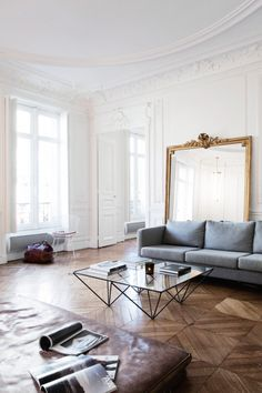 Leaning a mirror against the wall, like a piece of furniture, imparts a bit of a casual feel. Image from Vogue Australia.