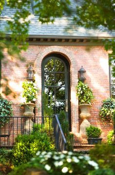 Save for visual of Black door next to orange brick - French inspired home in Charleston, SC