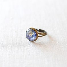 Juju Treasures Planet Earth Ring ($17) ❤ liked on Polyvore featuring jewelry, rings, cowgirl jewelry, cowboy jewelry, western jewelry, galaxy ring and planet rings