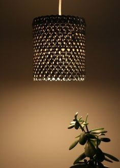 Pendant Light Made From Soda Can Tabs And Then Hot Glue