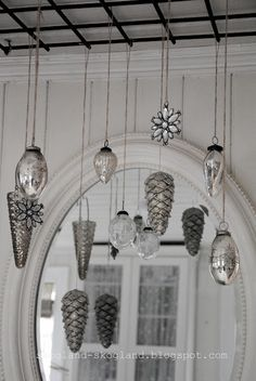 Hanging ornaments in front of a mirror to multiple a small collection