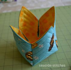 Fabric Box Tutorial - with the points inside...have seen this with the points outside and only one flap turned down..the maker of that one added a plastic container to help it keep its shape. The points inside should add a bit of support -depends on how you want the result to look and if you have a suitable plastic container!