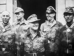 Sepp Dietrich & friends…possibly Kurt Meyer in the back? Wilhelm Mohnke on left, so I am told.  Mohnke was awarded the Knight's Cross on 11 July 1944, so it is possible that this photo was taken on that day…