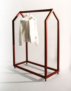 Clothing House(by Ola Giertz) Producer: Essem Design (www.se)Hang your clothes in their own little house. Instead of living in a dark, square wardrobe, they now can be seen in another