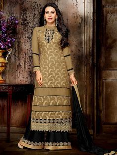Glamorous golden beige color long #Kameez fabricated on #Georgette having golden zari work. Item code : SLEB8016 http://www.bharatplaza.com/new-arrivals/palazzo-suits.html