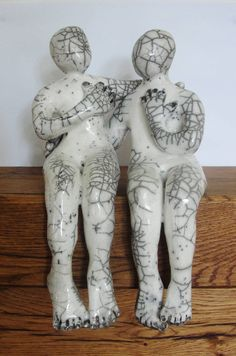 Excited to share the latest addition to my #etsy shop: Raku Ceramics Couple. Unique Raku sculpture made of two separate figures hugging. http://etsy.me/2AEee3W #art #sculpture #white #wedding #black #raku #rakusculpture #couple #lovesculpture