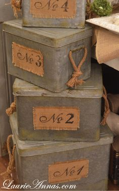 Paint tins same color and distress a little so all match - add burlap or printed vintage labels?Love these rustic tin storage boxes Burlap Projects, Burlap Crafts, Diy Projects, Vintage Decor, Rustic Decor, Vintage Numbers, Hat Boxes, Metal Box, Industrial Chic