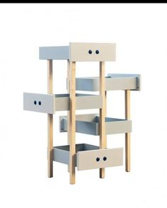 Most cats can't resist an open drawer, so why not upcycle some old drawers into a cat tower?