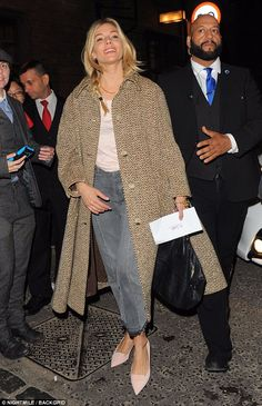 Stage star: Sienna Miller seemed in good spirits as she headed home after another triumphant evening on stage at the Apollo Theatre in London on Friday