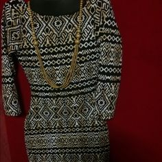Tribal print brown and black long dress Tribal peon brown and black dress , worn once . Snug fit . Necklace not included but for sale . Dresses