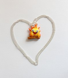 handmade polymer clay necklace of calcifer from Howl's Moving Castle. on sale at: https://www.etsy.com/listing/163334105/howls-moving-castle-calcifer-necklace