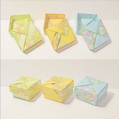 January 7th 2015 Small origami boxes I made today. They measure 4x4x2 cm. #origami #paper #folding #box #flower #yellow #orange #green #blue #7