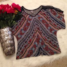Dark Blue Aztec Top This top has lace on the top of the shirt and on the top of the back of the shirt! The front is sheer and a little see through! The back is completely dark blue! Short sleeves! Gently used! Vanity Tops