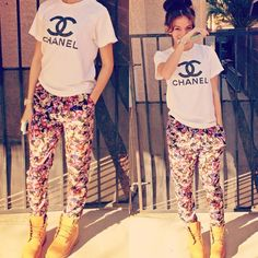 LOVE the floral trousers and white top combo but the timberlands complete this look