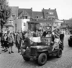 Dutch civilians rode on a British jeep during the advance towards Nijmegen, the Netherlands, 20 Sep 1944.