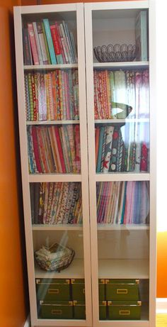 Smashed Peas and Carrots: Mini Fabric Bolts and Some Studio Organization. I am loving those glass bookshelves and her fabric storage ideas!
