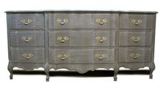 Gray french provincial with brass accents.