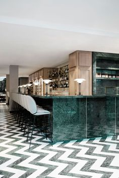 Flora Danica at Maison du Danemark in Paris by GamFratesi | Yellowtrace. Green marble bar front with light coloured oak back bar and zig zag marble flooring detail