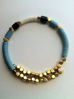 Sequin bangle bracelet with aqua, white and black sequins and gold color pewter spacers. Bracelet fits small to medium wrist. Cute Jewelry, Jewelry Gifts, Jewelry Bracelets, Jewelery, Jewelry Accessories, Handmade Wire Jewelry, Handmade Bracelets, Beaded Jewelry, Diy Bracelet Designs