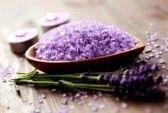 bowl of lavender bath salt - beauty treatment stock photography