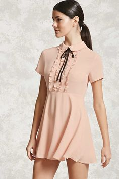 A crepe woven mini dress in an A-line silhouette featuring a faux button placket, ruffled trim along the front, a peter pan collar with a bow accent, short sleeves, and a concealed back zipper. Casual Dresses, Short Dresses, Fashion Dresses, Dresses For Work, Women's Dresses, Party Dresses, Ruffle Collar, Collar Dress, Ruffle Sleeve