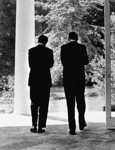 President Kennedy and Attorney General Robert F. Kennedy confer. White House, West Wing Colonnade. October 3, 1962.