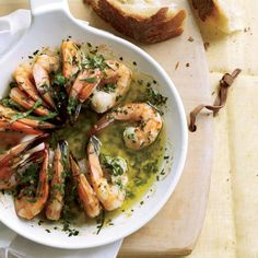 Sizzling Shrimp Scampi | Scampi refers to shrimp that are split, brushed with garlicky butter and broiled. The recipe here calls for flavoring butter with lemon, garlic, parsley and thyme, then dotting it liberally on shrimp and roasting the shellfish until it sizzles.