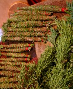 Crafting smudge wands from evergreen- a great way to make your house smell Christmas-y and use leftover branches.