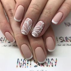 Detailed white lace on nude nail