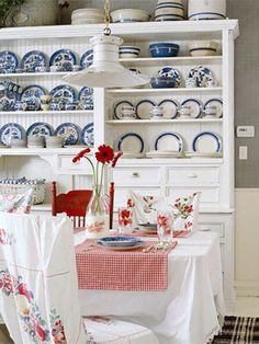 I love both blue and red, but in this picture, I think I love the blue dishes.