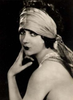 1920's Fashion.  Head wrap sets off the wide eyed look.