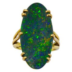 A Long Oval Black Opal Ring | From a unique collection of vintage solitaire rings at http://www.1stdibs.com/jewelry/rings/solitaire-rings/