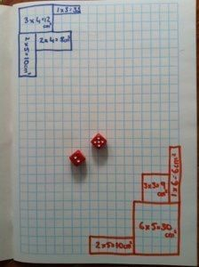 A game for 2 or 3 players. Each player chooses a color pencil they will use in the game. Players take turns rolling the dice, using the numbers that they rolled to draw the perimeter of a rectangle or square writing the area in the middle of the shape. Game ends when players run out of room to draw. Winner is the player who has used the largest area/most squares.