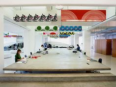 Clive Wilkinson seems to like communal tables. (His design for the ad agency Mother's offices in Shoreditch, London.)