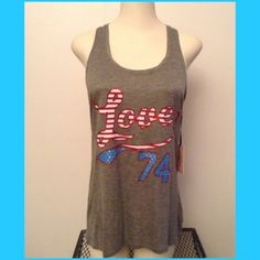 Juicy long grey tank with decor NWT Long grey tank by Juicy Couture, has Love 74 on front with sparkles and Stars in red whit and blue! Super soft , brand New with tags. Very soft, has logo on upper back .  Juicy Couture Tops Tank Tops