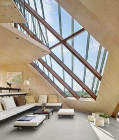 Split levels spiral through the interior of the house, itspolygonal shape derived from the island's dunes in  Terschelling, the Netherlands by Marc Koehler Architec...