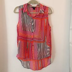 H&M Bright Safari Patterned Sleeveless Blouse sz6 Bright and fun colored flowy button-up top, many different prints and patterns, easy to pair with (I like wearing them with high-waisted bottoms), worn twice ✨ H&M Tops
