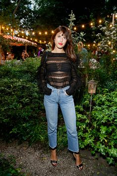 Jeanne Damas in a black lace blouse, straigh-leg jeans, and black sandals at the Isabel Marant x My Theresa event on July 4, 2016.